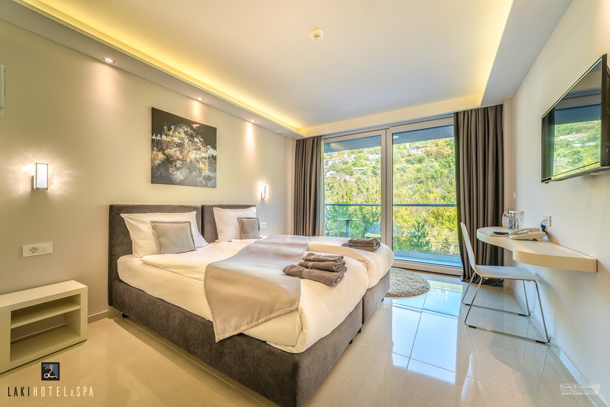 twin room with balcony and mountain view laki hotel spa. Black Bedroom Furniture Sets. Home Design Ideas